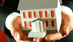 Man holding model home