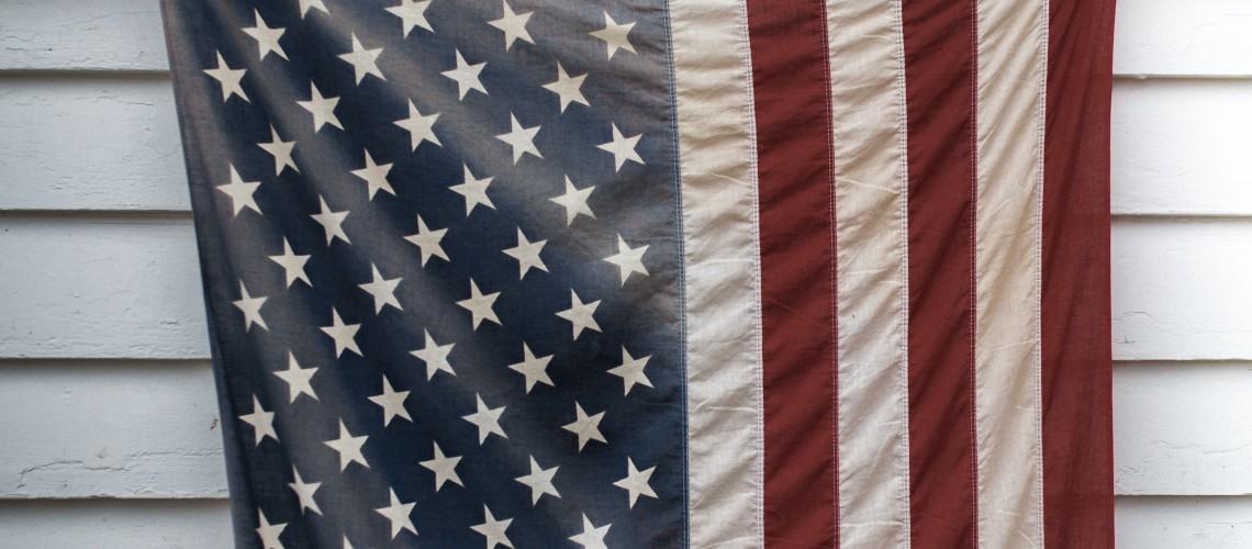 Flag on White Exterior Wall