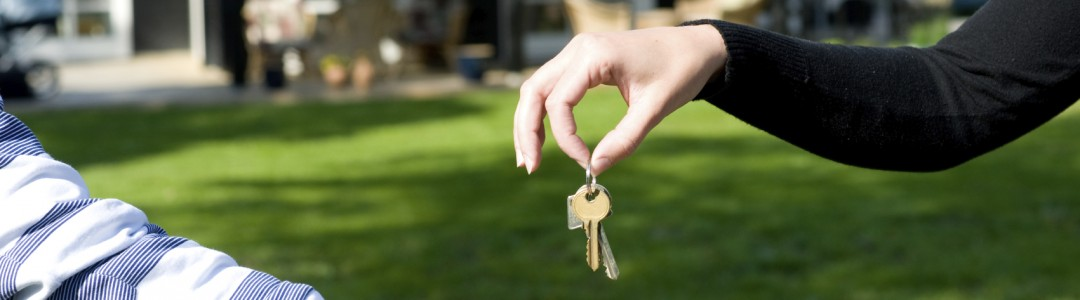 Handing over keys in yard of new home