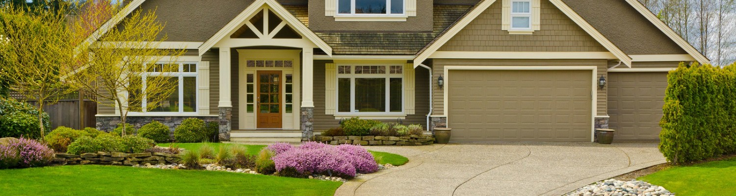 Large suburban home with landscaped yard