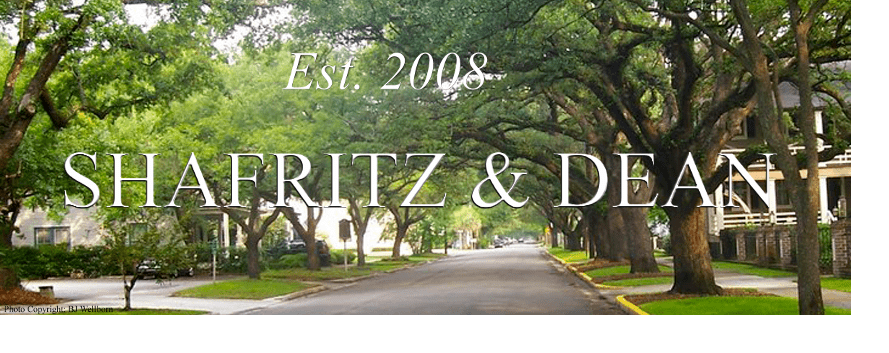 Tree lined residential street with Shafritz & Dean in text