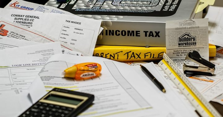 Income Tax books and documents spread out on a table