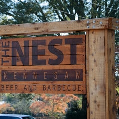 The Nest Kennesaw Beer and Barbecue sign