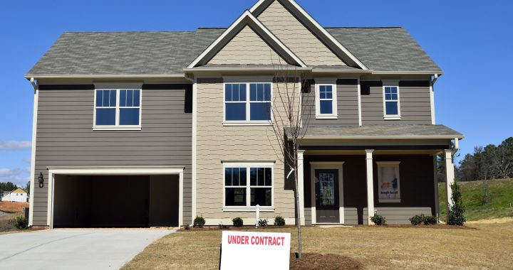 Suburban home with Under Contract sign in front