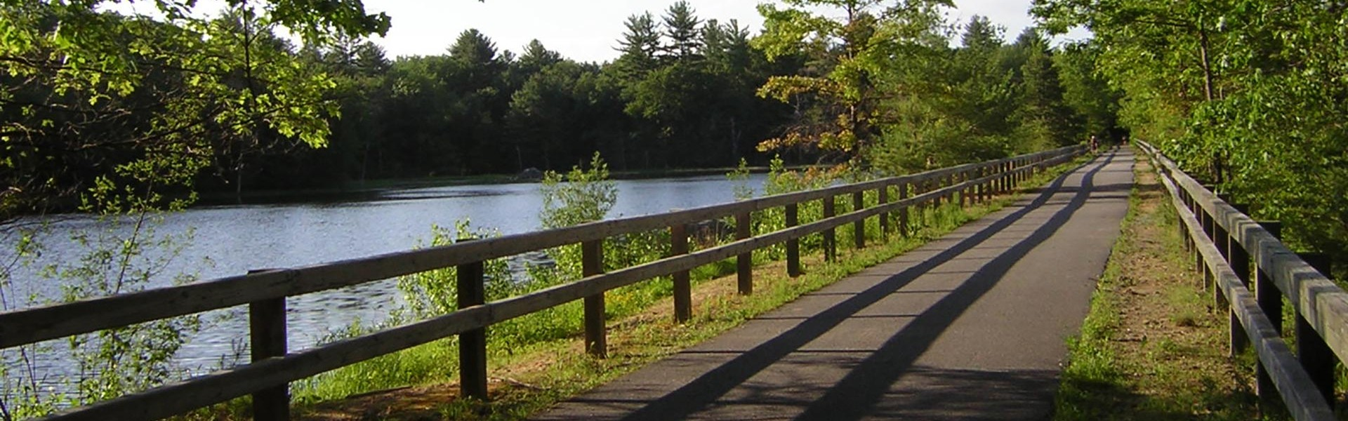 Paved walking trail beside a river